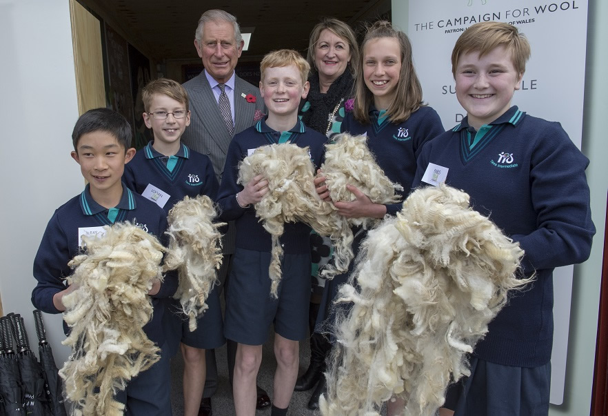 The Prince of Wales visit Tawa College, Wellington and  met with staff and students to highlight the school's achievements in the arts and sports.he also posed with students learning about NZ wool Picture: Arthur Edwards. The Sun London